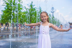 Portrait of little wet happy girl in street Stock Photography