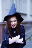 Portrait of a little witch Royalty Free Stock Image