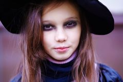 Portrait of a little witch Stock Image