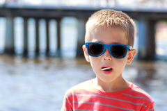Portrait of little young boy kid at sea. Summer. Stock Image