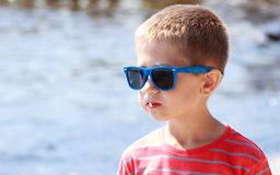 Portrait of little young boy kid at sea. Summer. royalty free stock photography