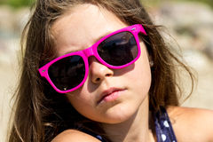 Portrait of little young girl kid at sea. Summer. Royalty Free Stock Image