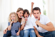 Portrait of a lively family singing Royalty Free Stock Photo