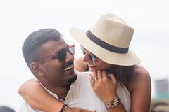 Portrait of living young couple at the beach. They are happy and smile. Concept of just married family Royalty Free Stock Image