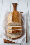 Portrait of a loaf. Sourdough bread loaf on a chopping board - shallow dof Royalty Free Stock Photo