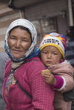 Portrait local woman with child on the street in Leh, Ladakh. India Stock Images