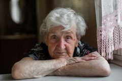 Portrait of an lone elderly woman close-up. royalty free stock photos