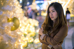 Portrait of lonely asian woman, outdoor in night. Christmas and New Year concept royalty free stock images