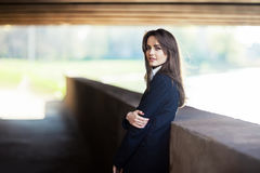 Lonely beautiful woman standing under the bridge Royalty Free Stock Images