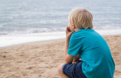 Portrait of a lonely boy at the beach. With copy-space Royalty Free Stock Photography