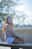 Portrait of long hair asian young lady in casual dress in her li Stock Photo