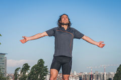 Portrait of a long haired athlete against blue sky Stock Image