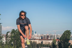 Portrait of a long haired athlete posing in a city park Stock Photos