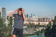 Portrait of a long haired athlete posing in a city park Royalty Free Stock Photo