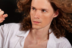 Portrait of long-haired handsome man Royalty Free Stock Photos