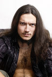 Portrait of long-haired young man sullen Stock Photography