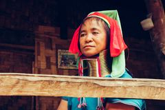 Portrait of long neck woman in traditional costume. Karen long neck tribe northern Thailand. Portrait of Long Neck Woman weave cloth in front her house in tribal stock images