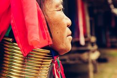 Portrait of long neck woman in traditional costume. Karen long neck tribe northern Thailand. Portrait of Long Neck Woman weave cloth in front her house in tribal royalty free stock photos