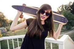 Portrait of longboarder girl Royalty Free Stock Image