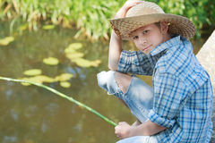 Portrait of looking at camera angling boy on Royalty Free Stock Photo