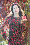 Portrait of looking at camera autumn girl in fall Royalty Free Stock Photography