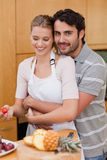 Portrait of an in love couple eating fruits Stock Photography