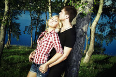 Portrait of love couple embracing outdoor in park Stock Photo
