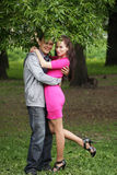 Portrait of love couple embracing outdoor in park Royalty Free Stock Image