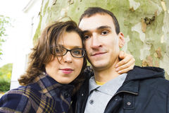 Portrait of love couple embracing outdoor. In park looking happy Royalty Free Stock Photography
