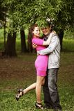Portrait of love couple embracing outdoor in park Stock Photos