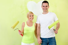 Portrait of love couple with paint rollers Stock Photography