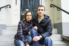 Portrait of love couple sitting on traditional Dutch porch looki Royalty Free Stock Image