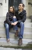 Portrait of love couple sitting on traditional Dutch porch looki. Ng happy Stock Image