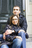 Portrait of love couple sitting on traditional Dutch porch looki Stock Image