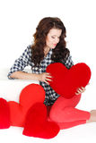 Portrait of Love and valentines day woman holding heart smiling cute and adorable isolated on white background. Beautiful woman in. Valentine's Day. Beautiful Royalty Free Stock Images