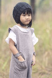 Portrait of lovely asian children with winter wool hood standing stock image