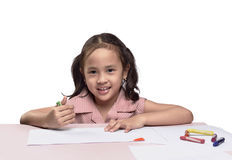 Portrait of lovely asian girl drawing with colorful crayon. Isolated over white background Royalty Free Stock Images
