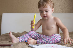 Portrait of lovely baby drawing with colorful pencils royalty free stock image
