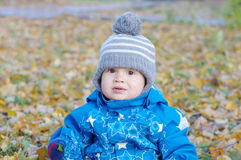 Portrait of lovely baby in gray hat in autumn outdoors Royalty Free Stock Image