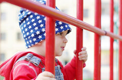 Portrait of lovely baby on playground Stock Photos