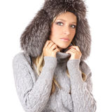 Portrait of a lovely blond in a winter hat Stock Images