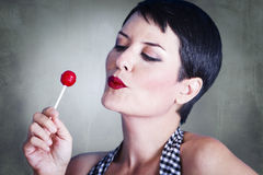 Portrait of lovely brunette with lolly pop Stock Photos