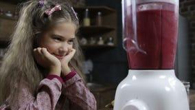 Cute girl blending fresh berry smoothie in blender stock video footage