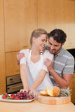 Portrait of a lovely couple eating fruits Stock Images