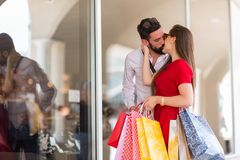 Portrait of lovely couple with shopping bags stock photos