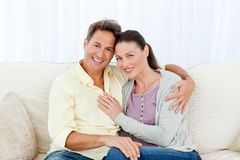 Portrait of a lovely couple on the sofa Stock Photo