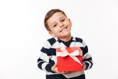 Portrait of a lovely cute little kid holding present box royalty free stock photos
