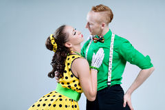 Portrait lovely funny dancer couple dressed in boogie-woogie rock'n'roll pin up style Stock Image