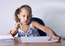 Portrait of lovely girl while drawing. Back to school concept Royalty Free Stock Photo