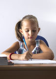 Portrait of lovely girl while drawing. Back to school concept Royalty Free Stock Photography